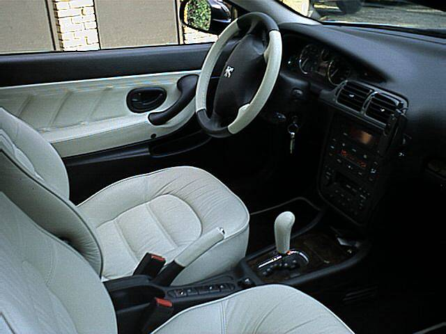 Essai coup peugeot 406 3 0 l v6 210 ch passion for Interieur 406